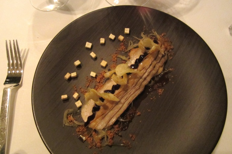 Charcoal belly of pork. Sauerkraut, apple, sauted potatoes foam &vinegar emulsion