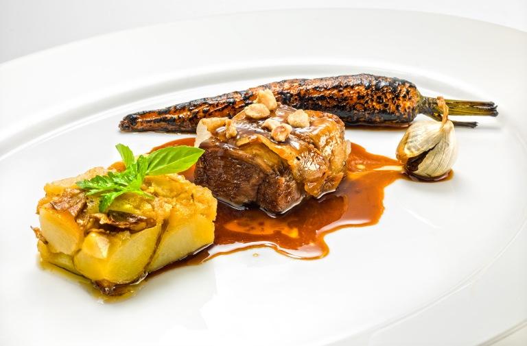 Lamb wrapped into mangalica bacon, potato, carrot. Photo: Janez Puksic